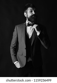 24a696724e42 Manager or speaker with stylish beard and moustache. Businessman with  surprised face adjusts bow tie