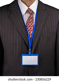 Manager in a suit with a tie and a badge on the neck