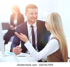 Manager talking with a colleague at the workplace