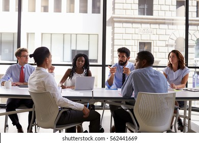 Manager talks to business colleagues at a meeting, close up