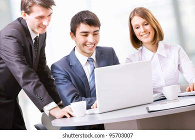 Manager talks to a young couple in the bank