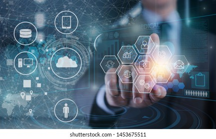 Manager Technical Industrial Engineer working and control robotics with monitoring system software and icon industry network connection on tablet. AI, Artificial Intelligence, Automation robot arm.
