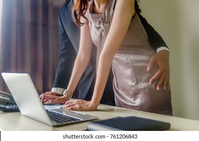 Manager touching his  secretary waist - sexual harassment in office ,Sexual harassment in the workplace concept
