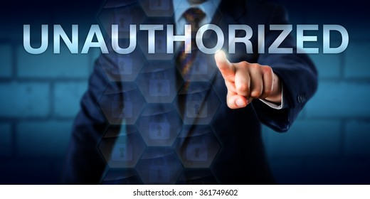 Manager is touching the word UNAUTHORIZED on a screen. Business metaphor and technology concept for computing access restrictions, information security and data confidentiality.