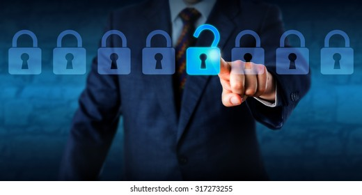 Manager is unlocking a virtual lock in a lineup of eight padlocks. Business concept and technology metaphor for cyber attack, computer crime, information security and data encryption. Copy space.