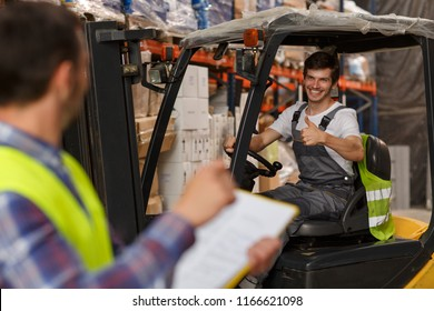 Manager of warehouse looking at loader, who smiling at him and showing thumb up. Forklift driver operating vehicle and posing. Concept of relations between colleagues and transportation of goods.