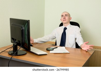 Manager in white shirt on a workplace