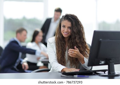 Manager woman sitting behind a Desk - Shutterstock ID 786737293