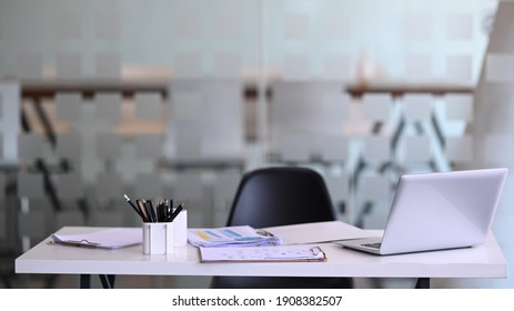 Manager working desk with laptop computer, document, paperwork and office suppliers.