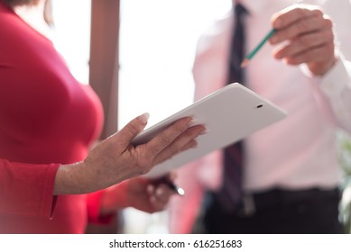 Manager working with executive assistant in office