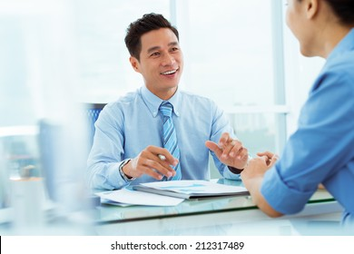 Managers discussing business ideas during the meeting