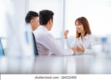 Managers interviewing young pretty applicant for a job
