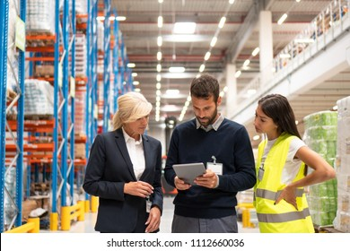 Managers and workers in distribution center