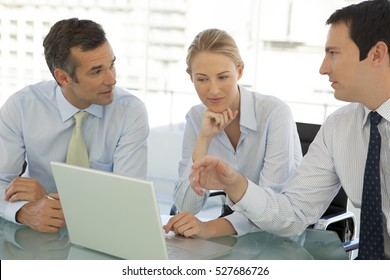 Managers working together at a business meeting