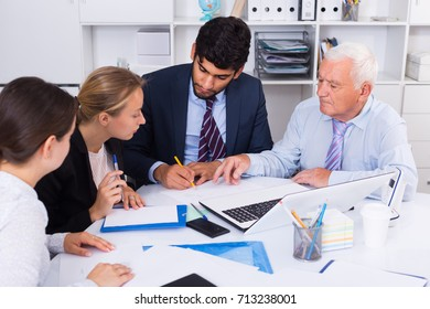 Managers are writing financial reports in the office.