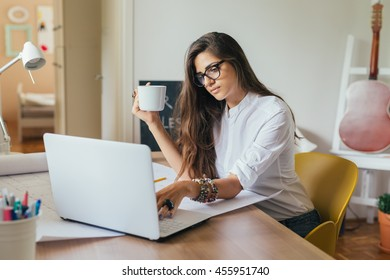 Managing her business from home.young woman working on a computer in her home office