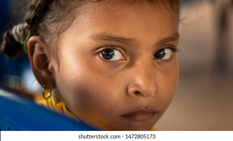 Managua, Nicaragua - June 16, 2018: Face of young girl attending a church service and food distribution sponsored by American missionaries. Extreme poverty and widespread hunger in third world nation.