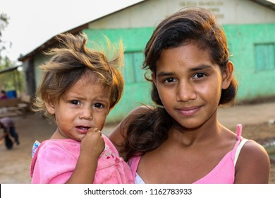 Managua, Nicaragua - May 11, 2017: Young girls visit a remote church to participate in programs and receive food from American missionaries. Smiling happy faces of children living in extreme poverty.