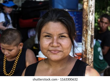 Managua, Nicaragua - May 11, 2017: A woman waits with for a food distribution from American missionaries at her church.