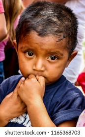 Managua, Nicaragua - May 11, 2017: A young boy waits in line for lunch served by American missionaries following a church program.