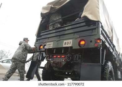 MANAHAWKIN,NJ-OCTOBER 29: The New Jersey National Guard evacuating residents and thier pets from Long Beach Island, NJ before Hurricane Sandy makes landfall.Oct 29 2012, Long Beach Island, NJ