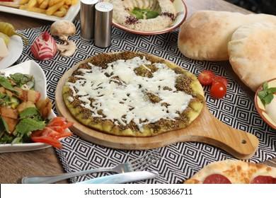 Manakish  zaatar and cheese with salad