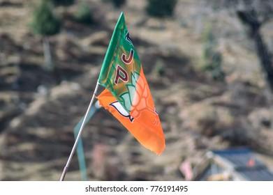 MANALI, HIMACHAL PRADESH, India - DECEMBER 2, 2017: BJP flag flying at MANALI district of HIMACHAL PRADESH state in india.