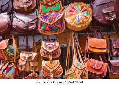 Manali, India, July 05, 2016:  An assortment of handmade leather bags hung outside a store in Manali, to attract travellers to buy a souvenir.  Some are embroidered with bright colours and patterns