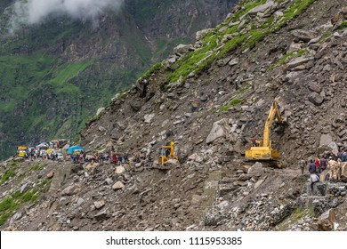 Manali, India - July 19, 2017: Excavator cleaning the Landslide area on the Manali - Leh Highway at the Rohtang pass area, HImachal Pradesh, India.