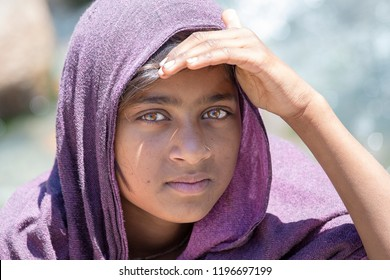 MANALI, INDIA - SEPTEMBER 16, 2014: Unidentified local young girl, outdoors in Manali begging money from tourists