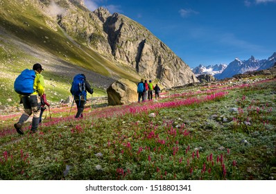 Manali, India - September 3, 2019: Unidentified hikers walk on trail with bag pack in Himalaya valley, Himachal Pradesh, India.