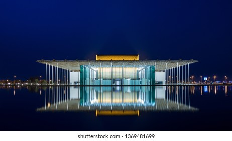 Manama, Bahrain 2015: Night view of Bahrain National Theater including water reflections