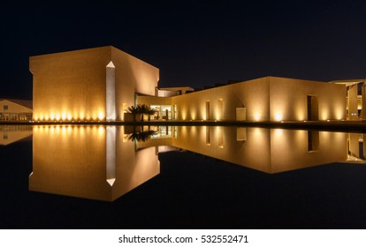 MANAMA, BAHRAIN, 22 APRIL 2016: Beautifully illuminated Bahrain National Museum at night with reflections -Manama, Bahrain.