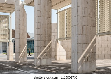 MANAMA, BAHRAIN - 24 FEBRUARY, 2017: A cleaner walks through the exterior courtyard of the Bahrain National Museum.