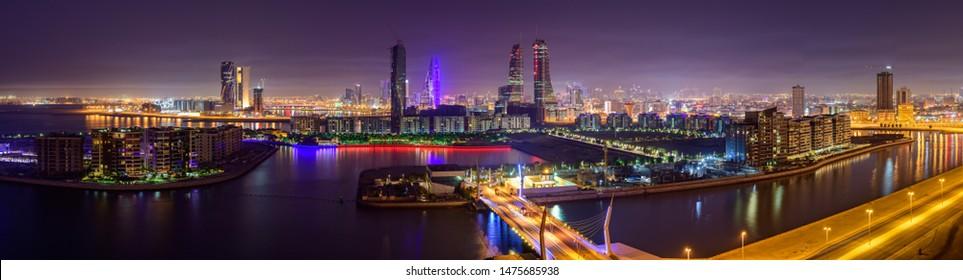 MANAMA, BAHRAIN - AUGUST 04, 2019: Panoramic view of  Manama city and skyline at blue hour, Manama, Bahrain