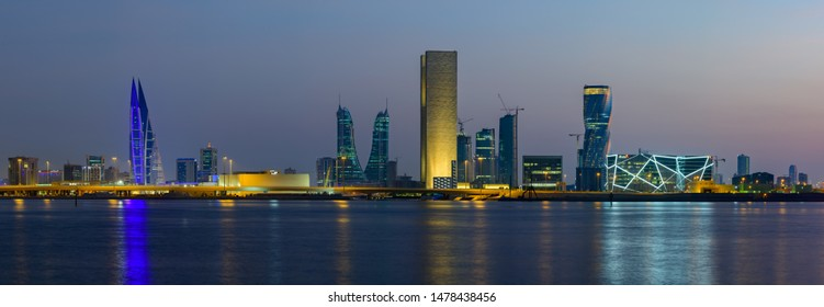 MANAMA, BAHRAIN - August 05, 2019: Panoramic view of Bahrain skyline after sunset with reflections.