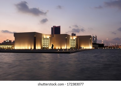 MANAMA, BAHRAIN - DEC 21: The National Museum of Bahrain illuminated at dusk. December 21st 2013 in Manama, Bahrain, Middle East