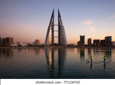 MANAMA, BAHRAIN - DECEMBER 06: Enthusiasts kyaking near the iconic building, the  World Trade Center of Bahrain on December 06, 2017, Manama, Bahrain.