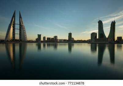 MANAMA, BAHRAIN -  DECEMBER 06: Bahrain skyline with iconic buildings, the Bahrain World Trade Center and the Financial harbour during dusk on December 06, 2017, Manama, Bahrain