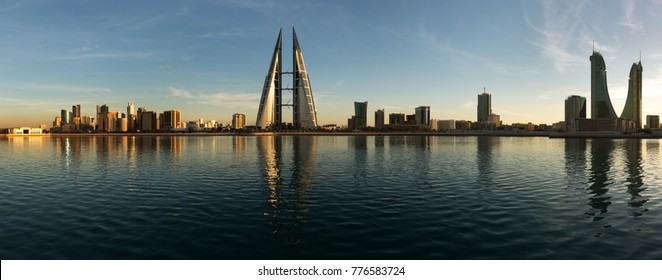 MANAMA , BAHRAIN - DECEMBER 06: Tallest iconic buildings, Bahrain Financial Harbour and World trade center during dusk, Manama, Bahrain on December 06, 2017