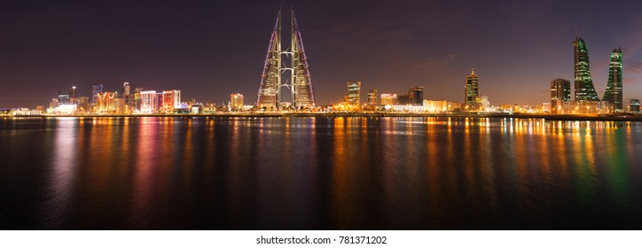 MANAMA, BAHRAIN - DECEMBER 25: The Bahrain World Trade Center at night, a twin tower complex is the first skyscraper in the world to have wind turbines, December 25, 2017, Manama, Bahrain