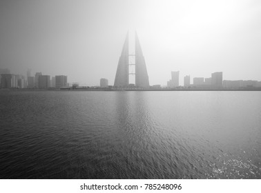 MANAMA, BAHRAIN - DECEMBER 29: The Bahrain World Trade Center during a foggy day. This building is the first skyscraper in the world to have wind turbines, December 29, 2017, Manama, Bahrain