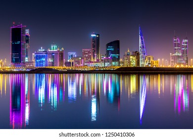 Manama, Bahrain - Feb 5th 2018 - The skyline of Manama, capital of Bahrain with the World trade Center building at night and water reflection