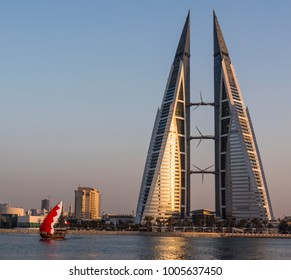 Manama, Bahrain - Bahrain flag with a fishing boat near Bahrain World Trade Center taken on 4th Nov 2017