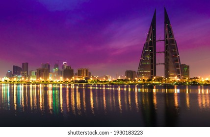MANAMA, BAHRAIN - Jan 01, 2020: View of Bahrain World Trade Center a commercial building illuminated with LED lights at night  This is the first building have wind mills i