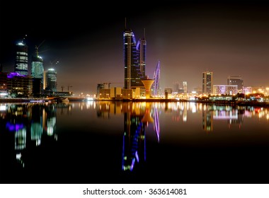 MANAMA , BAHRAIN - JANUARY 15: Bahrain Financial Harbour building at night, one of tall twin towers in Manama, Bahrain on January 15, 2016