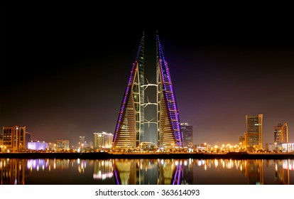 MANAMA, BAHRAIN - JANUARY 15: Bahrain World Trade Center at night, a twin tower complex is the first skyscraper in the world to have wind turbines, photographed on January 15, 2016, Manama, Bahrain