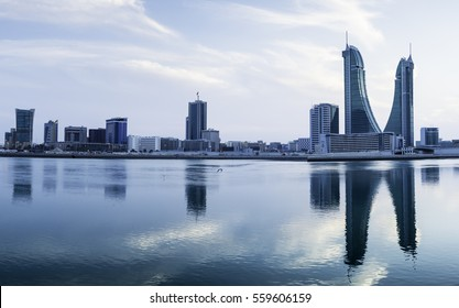 MANAMA , BAHRAIN - January 18: Panorama view of Bahrain Financial Harbour buildings at sunset blue hour, tallest twin towers in Manama, Bahrain on January 18, 2017