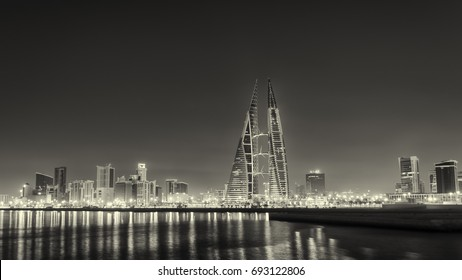 MANAMA, BAHRAIN - July , 2014: Beautiful view of the World Trade Center and other high rise buildings fully illuminated at night  in Manama on July 11, 2014 in Manama, Bahrain