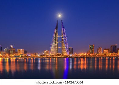 MANAMA, BAHRAIN - JULY 24, 2018: Beautiful view of Bahrain World trade center after sunset, blue hour, with moon background, Manama city, Bahrain